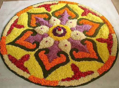 Rangoli designs with flowers the colors of celebration for Floor rangoli design